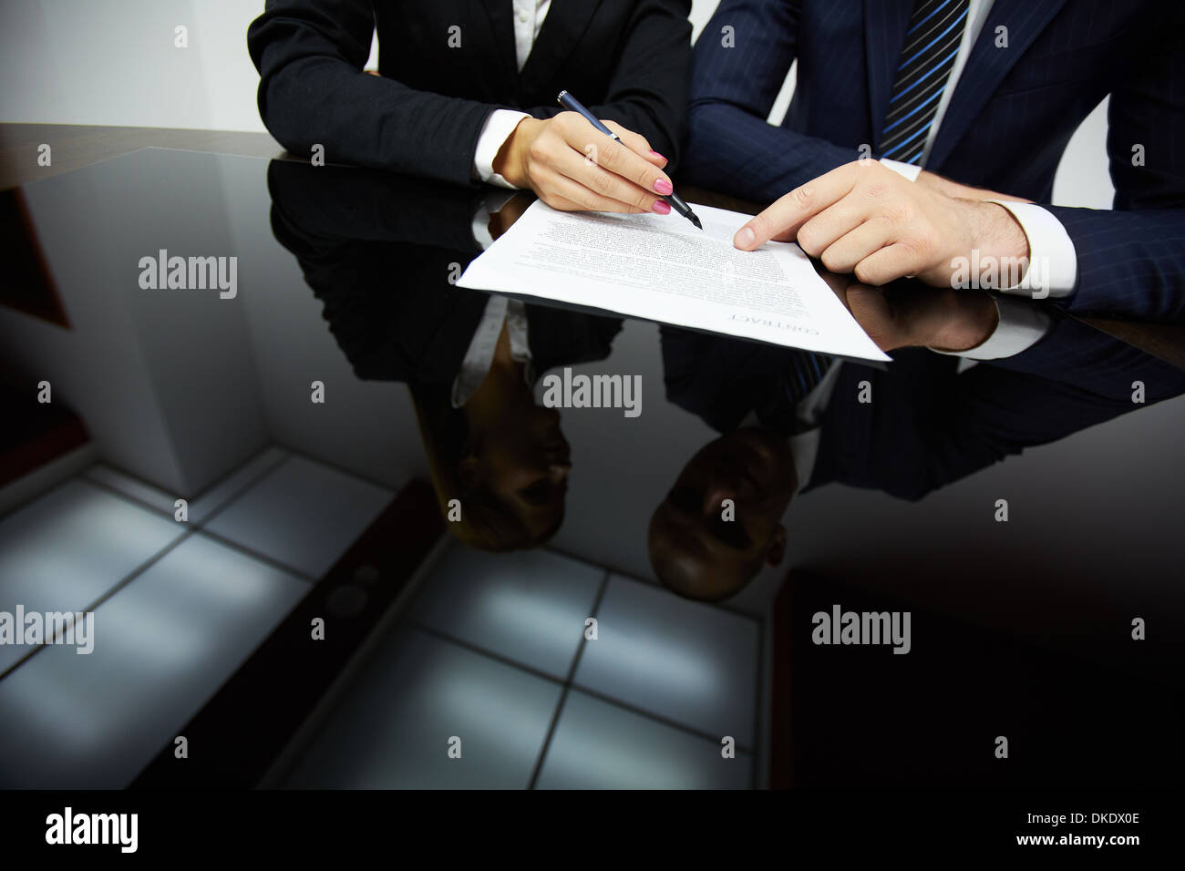Image of human hands during reading contract - Stock Image