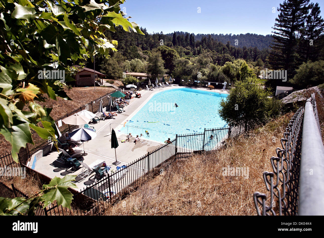 Residents enjoy the warm weather at the community pool in La Honda