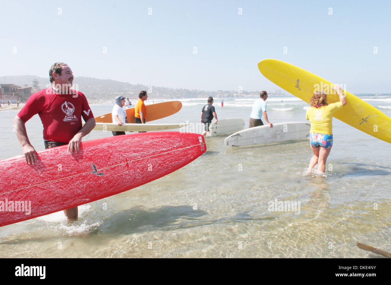 Aug 19, 2007 - La Jolla, CA, USA - Surboard shaper and owner of Rusty clothing RUSTY PREISENDORFER (red baord) with Surfer and cancer survivor JERICHO POPPLER (yellow board) at the 14th Annual Luau and Longboard Invitational at Scripps Institute of Oceanography. (Credit Image: © Kohlbauer Don/SDU-T/ZUMA Press) RESTRICTIONS:  LA and Orange County Papers RIGHTS OUT! and USA Tabloid R - Stock Image
