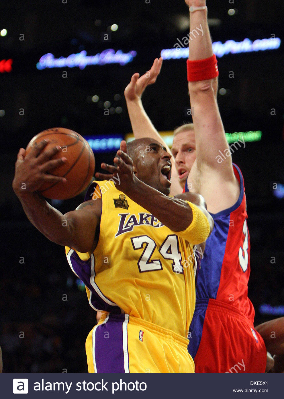free shipping 06c7a 900d5 Los Angeles Lakers  Kobe Bryant (24) scores past Los Angeles Clippers   Chris Kaman (35) in the first half against the of a basketball game at the  Staples ...