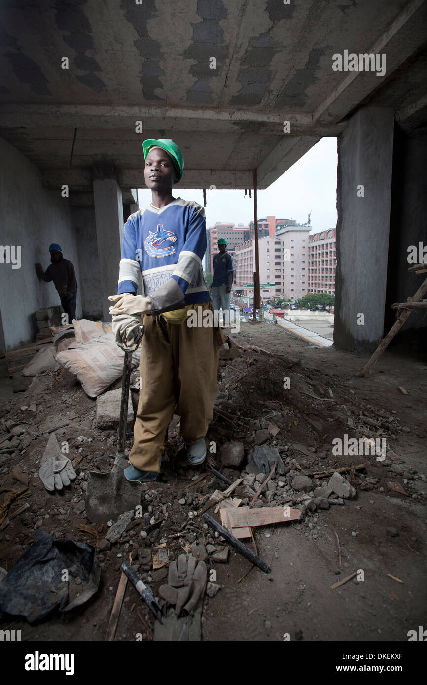 Construction workers on a high rise building site, Nairobi, Kenya - Stock Image