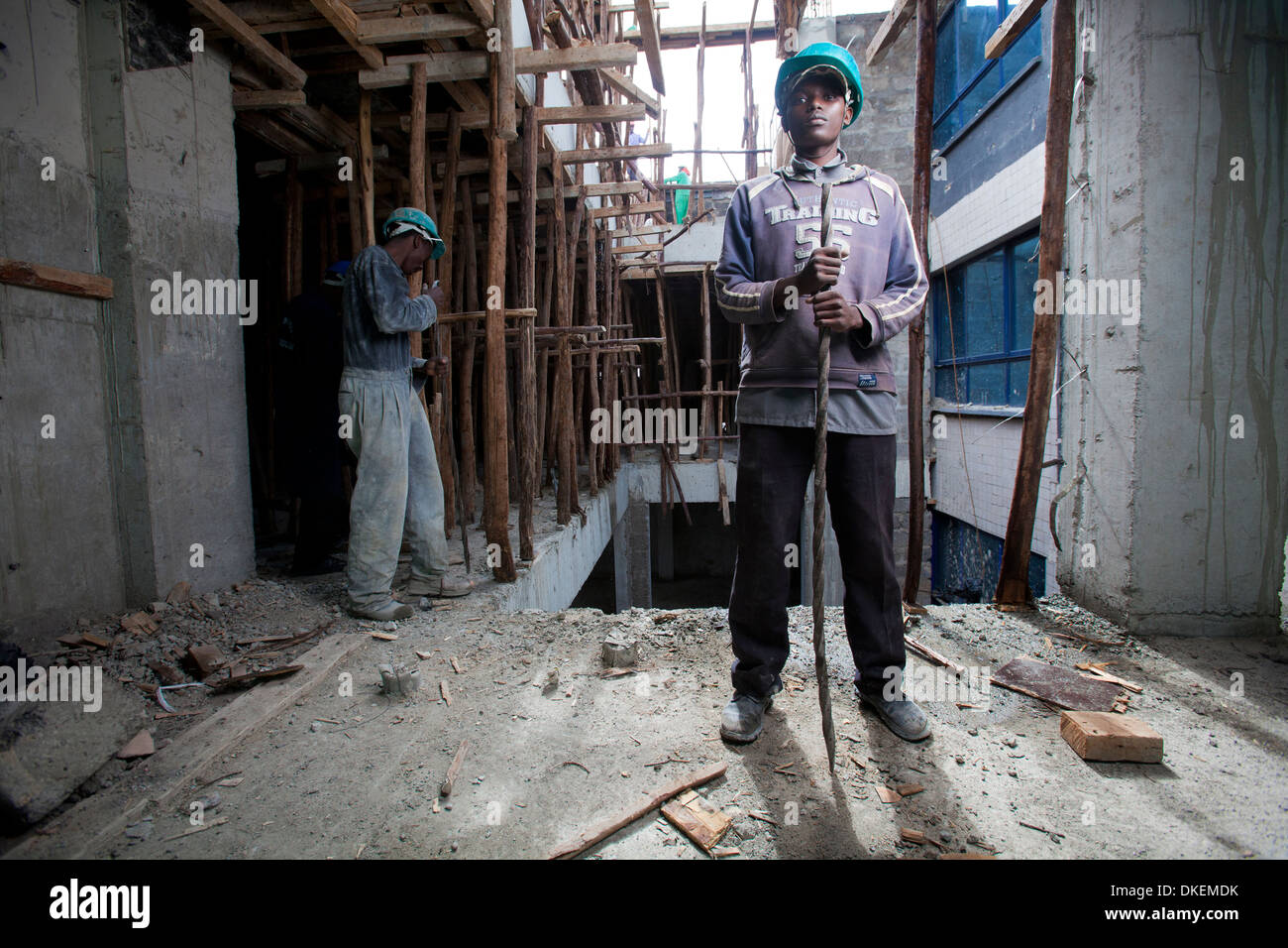 Construction worker on a high rise building site, Nairobi, Kenya - Stock Image