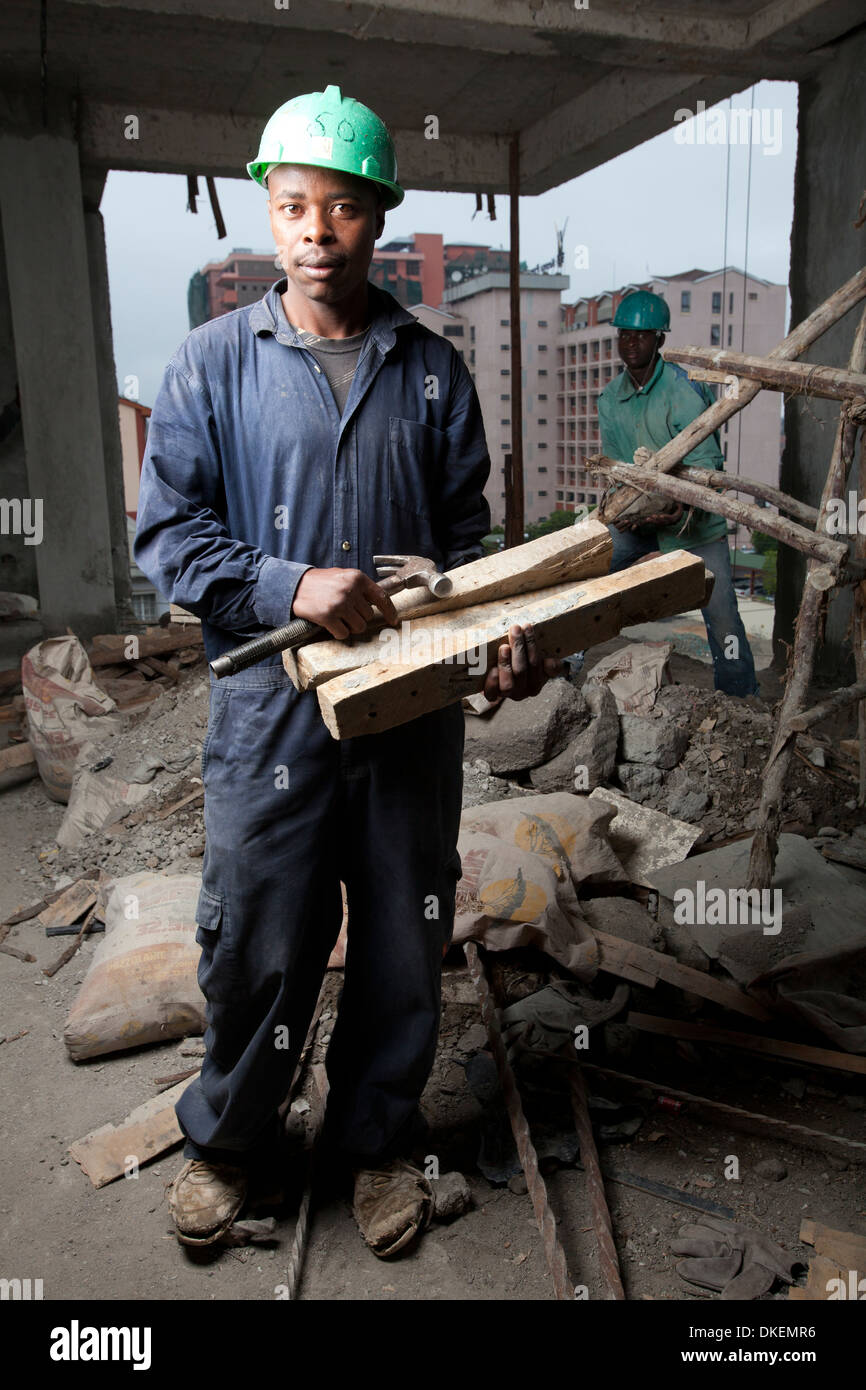 Portrait of a carpenter worker on a high rise building site, Nairobi, Kenya - Stock Image