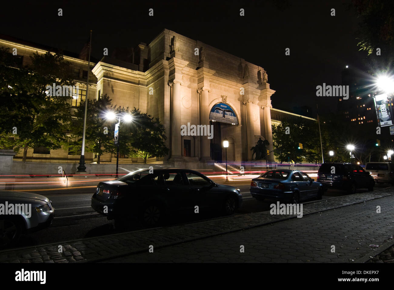 The American Museum of Natural History illuminated at night on Central Park West and 81st Street in New York City - Stock Image