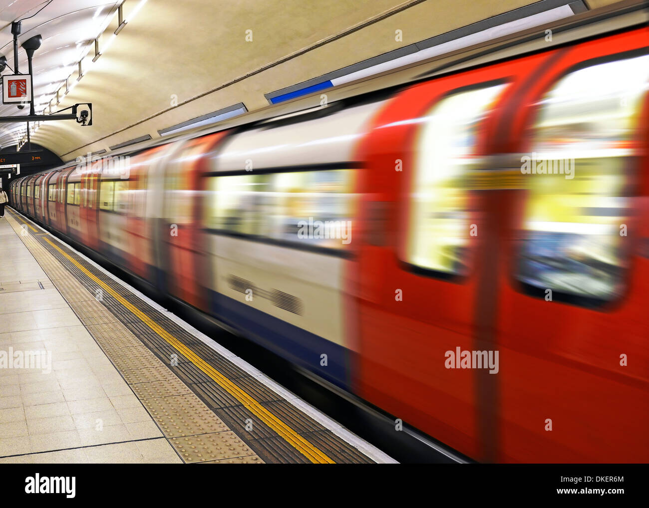London Underground Train Pulling Out of a Station, Charing Cross, London, Uk. - Stock Image