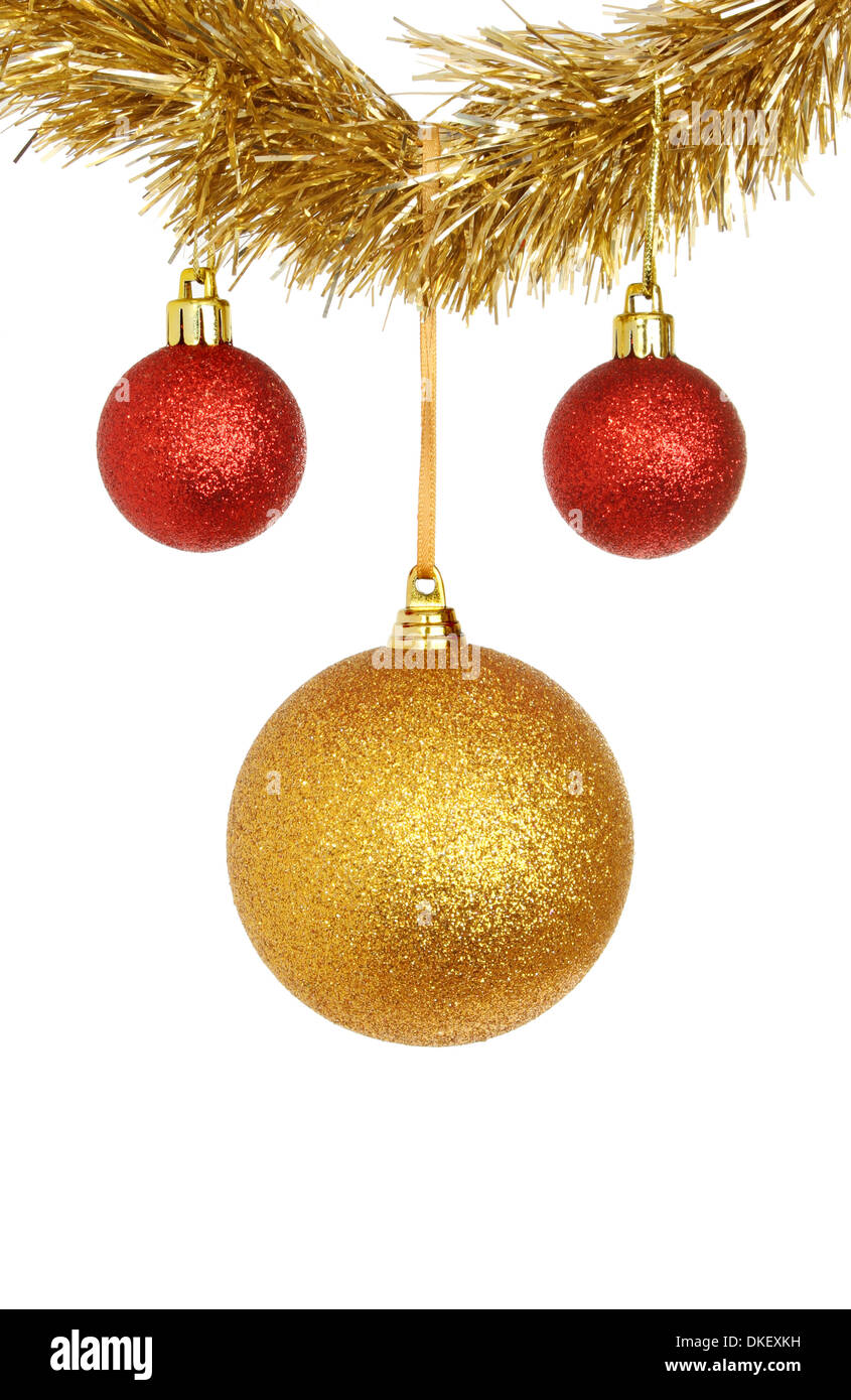 red and gold bauble christmas decorations hanging from tinsel isolated against white