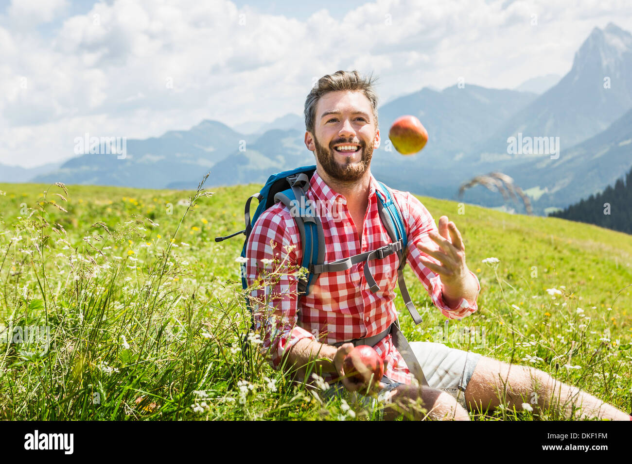 Man throwing apple, Tyrol, Austria - Stock Image