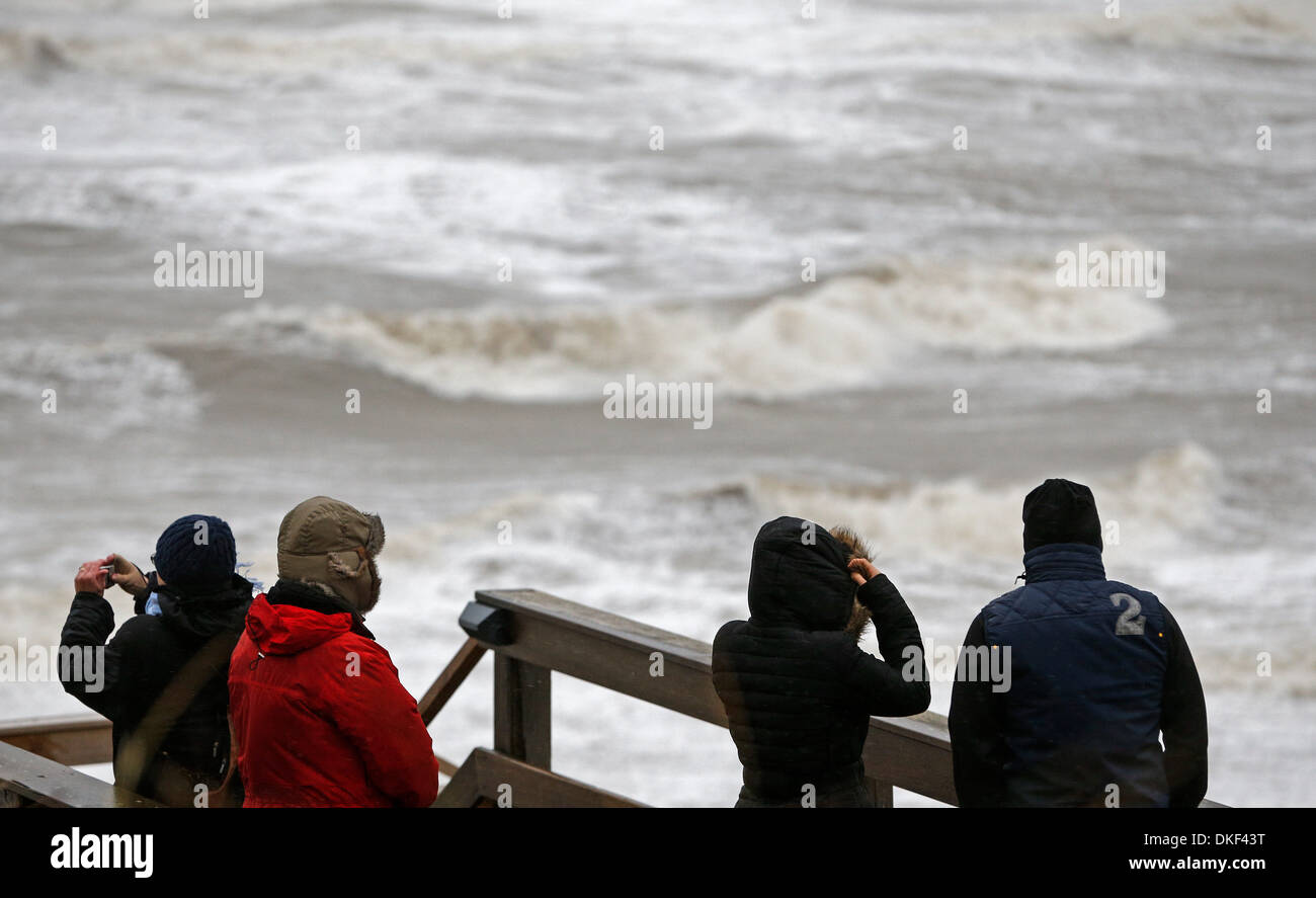 Sylt, Germany. 05th Dec, 2013. People Watch As Waves Lash The North