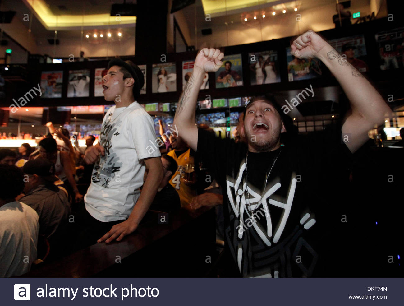 Laker fans cheer as they watch the Los Angeles Lakers play