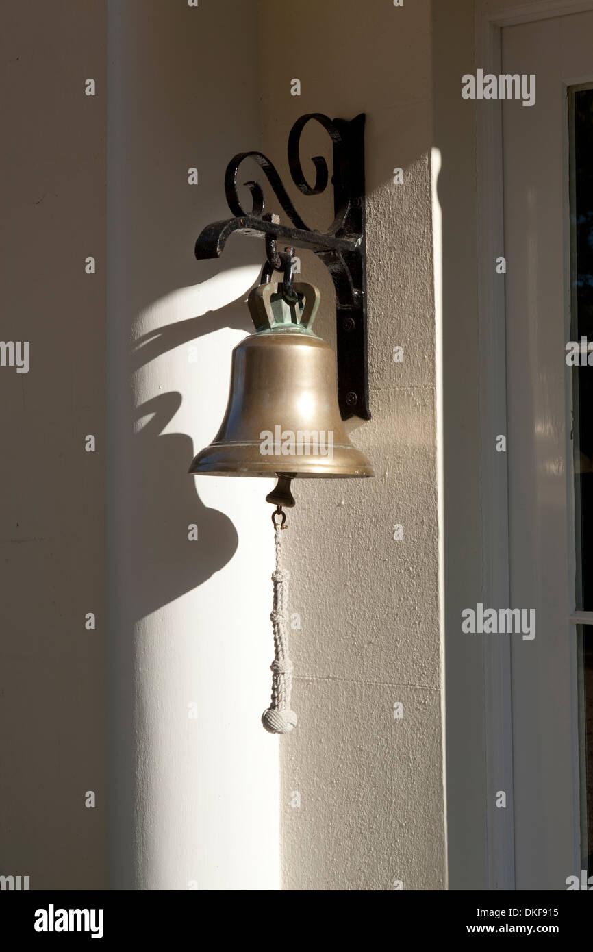 Beau Traditional Hanging Brass Front Door Bell In Sun Light