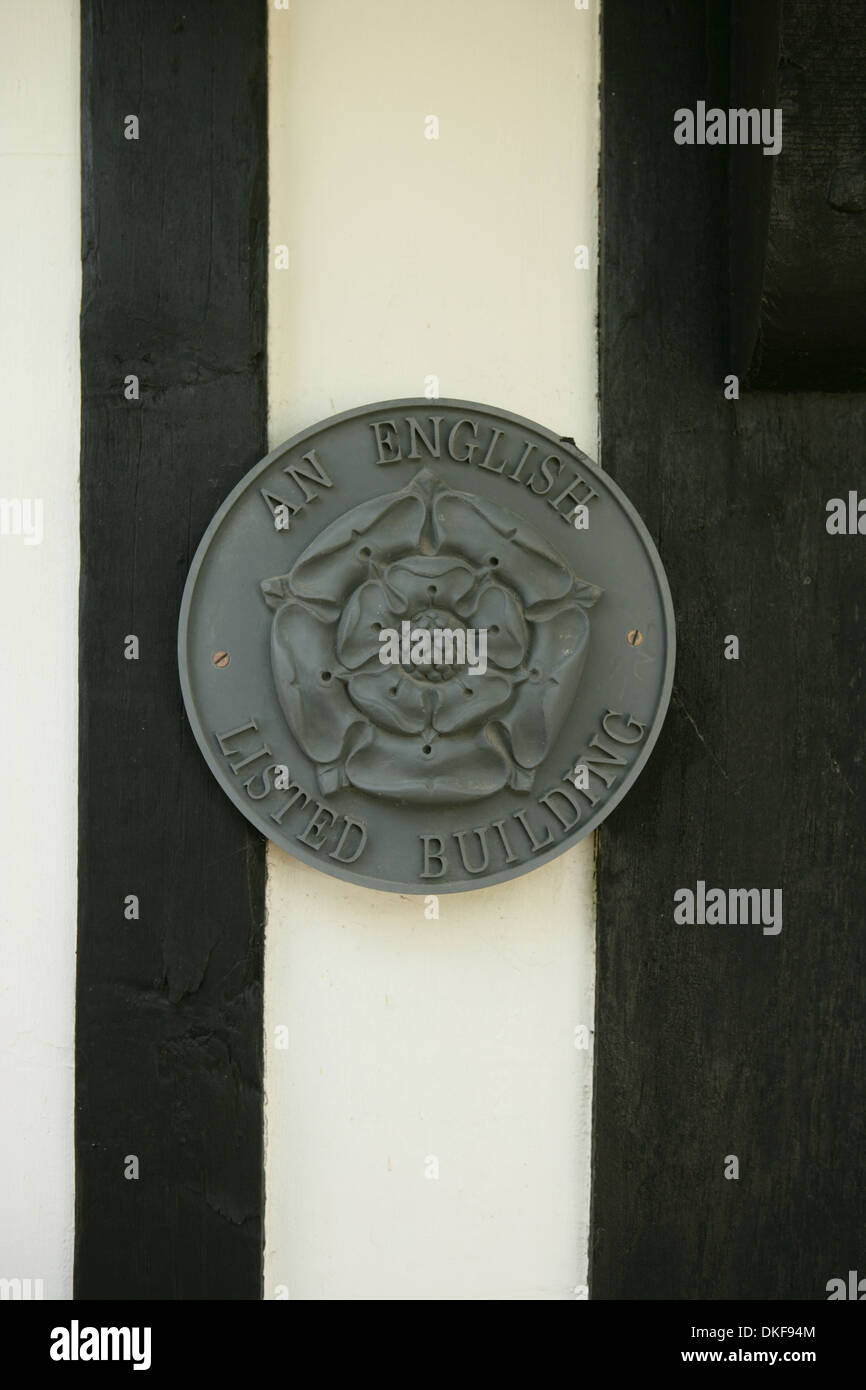 English listed building plaque on old timber-framed house - Stock Image