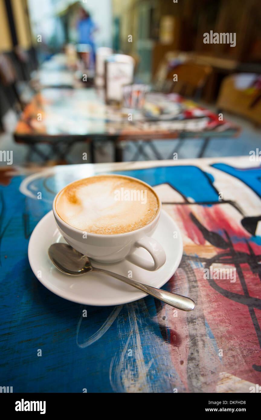 Cappuccino in a sidewalk cafe, Sestri Levante, Riviera di Levante, Genoa, Liguria, Italy - Stock Image