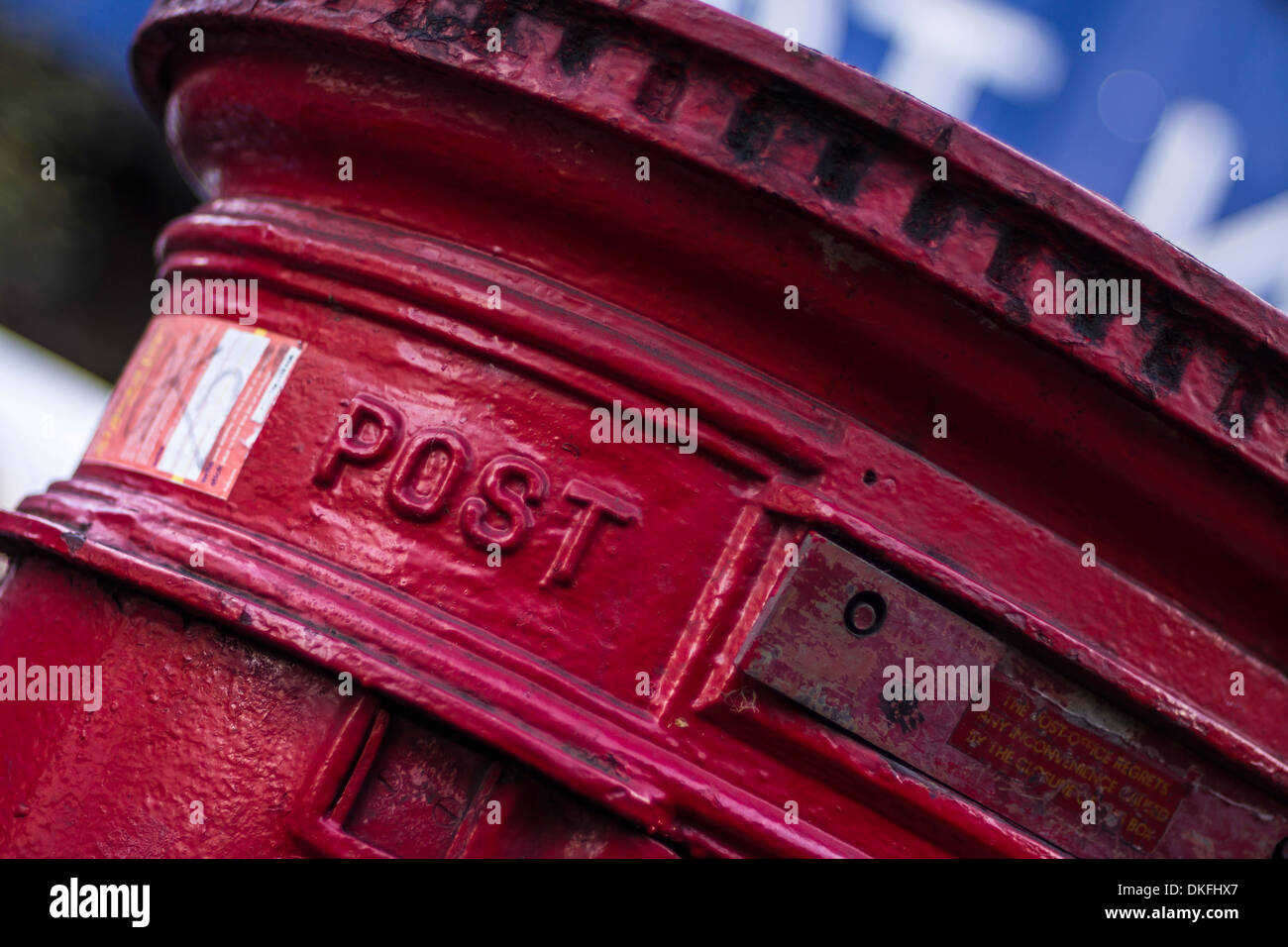 Close up detail image of a UK Royal Mail Red Pillar Box with the word POST clearly shown. Stock Photo