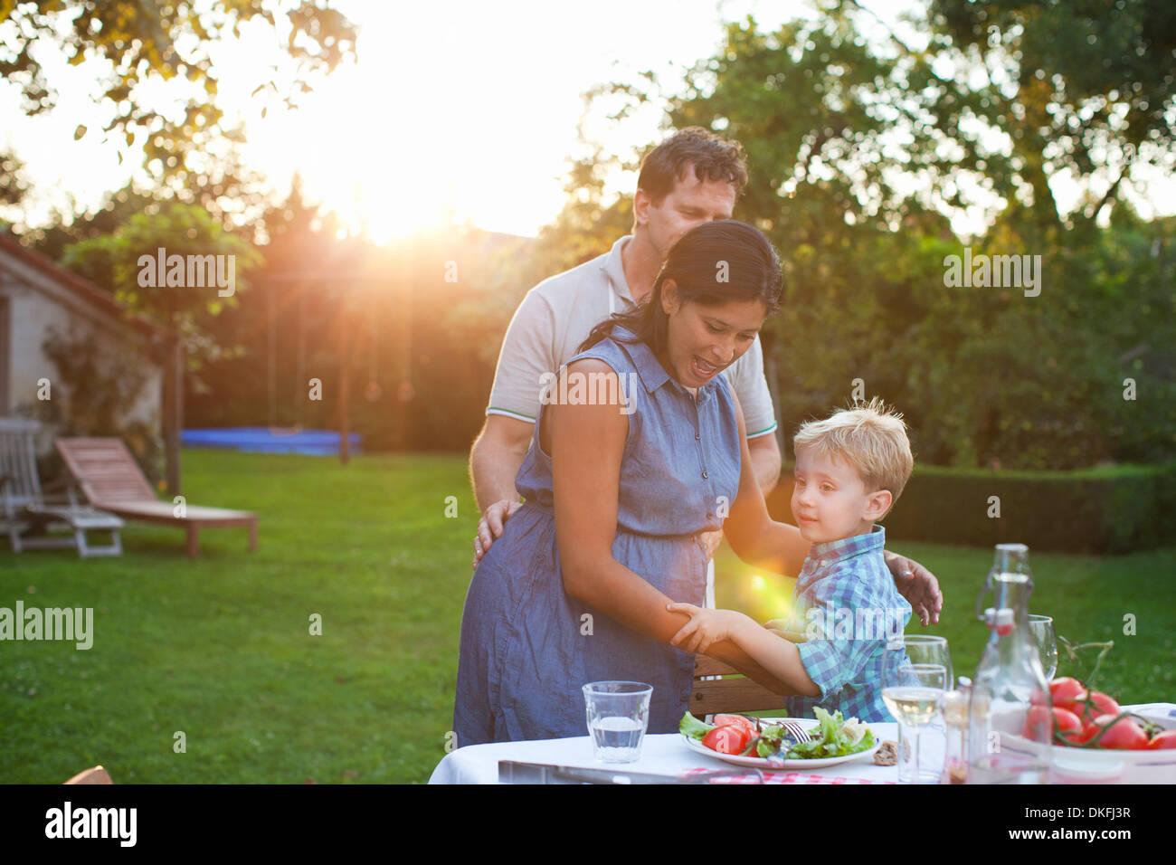 Family having dinner in garden - Stock Image