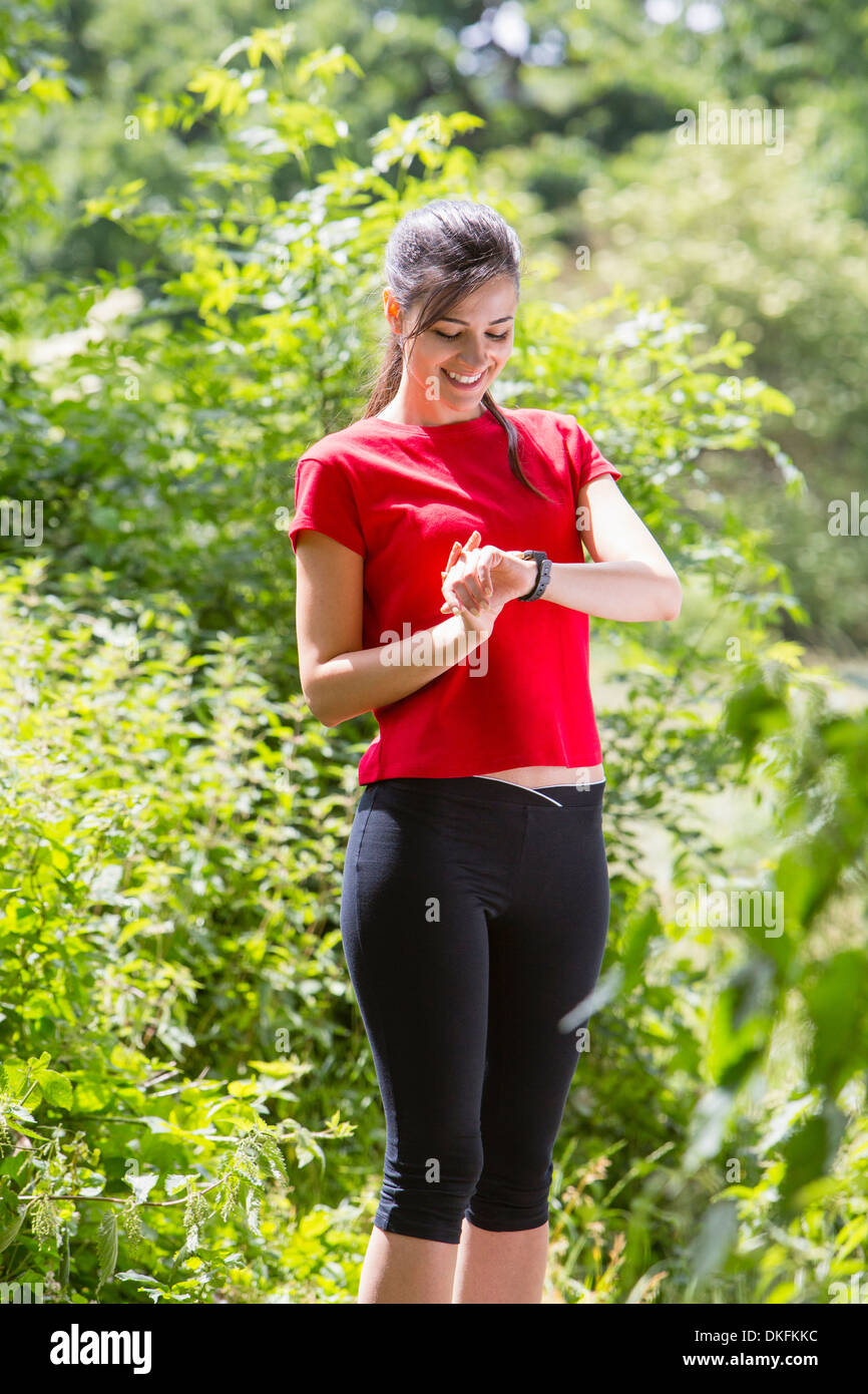 Jogger checking the time - Stock Image