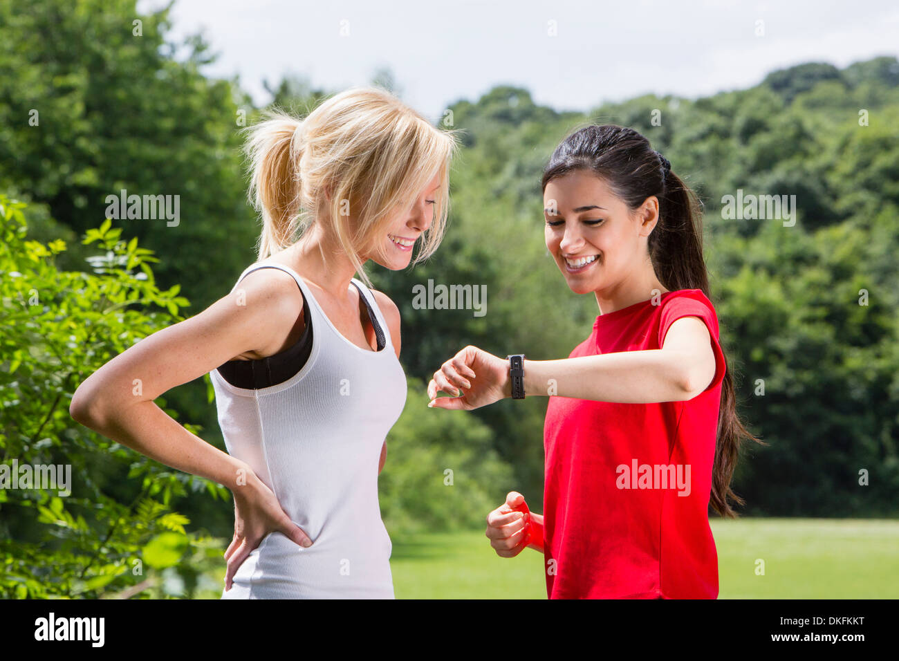Joggers checking the time - Stock Image