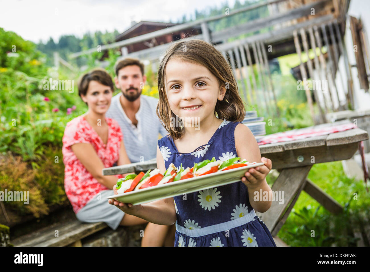 Young family preparing picnic lunch, Tyrol, Austria - Stock Image