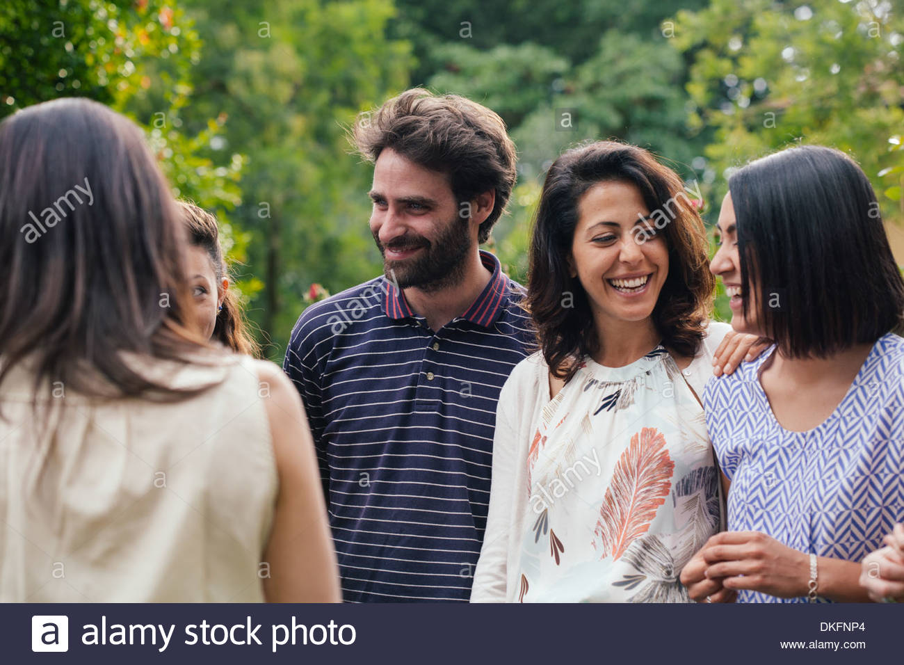 Family members talking at outdoor gathering - Stock Image