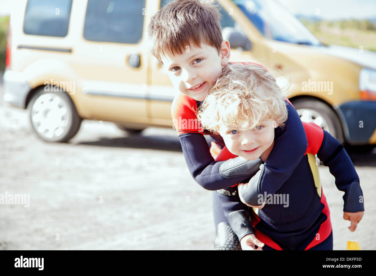Portrait of brothers wearing wet suits - Stock Image