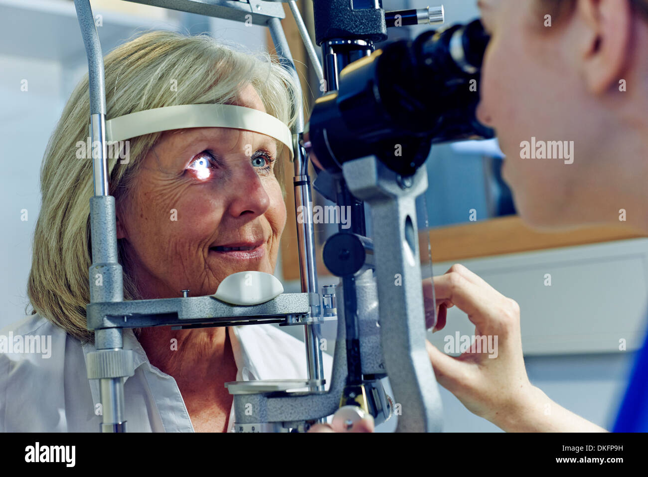 Female patient having eye tested in hospital - Stock Image