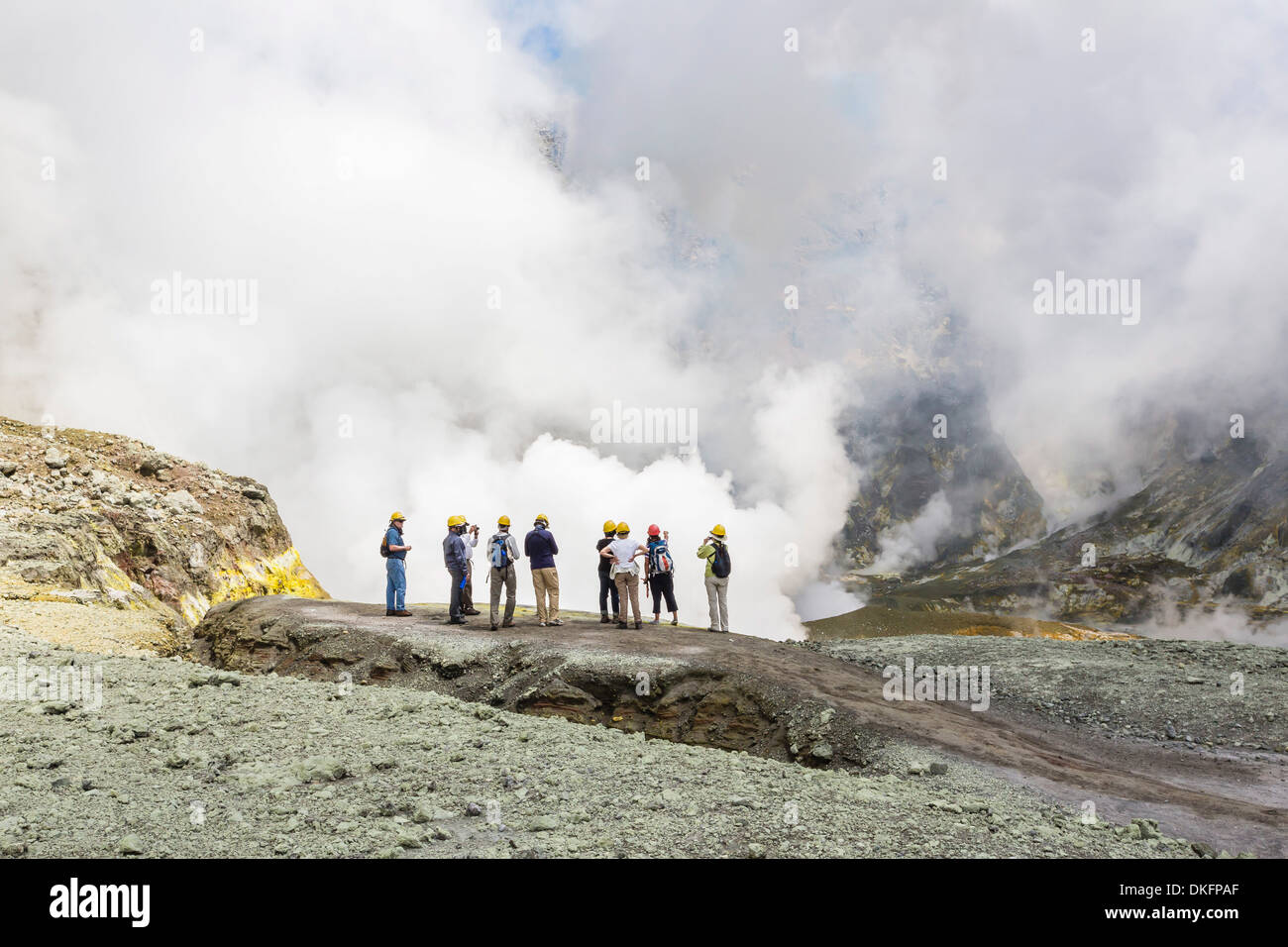 Visitors at an active andesite stratovolcano on White Island, North Island, New Zealand, Pacific - Stock Image