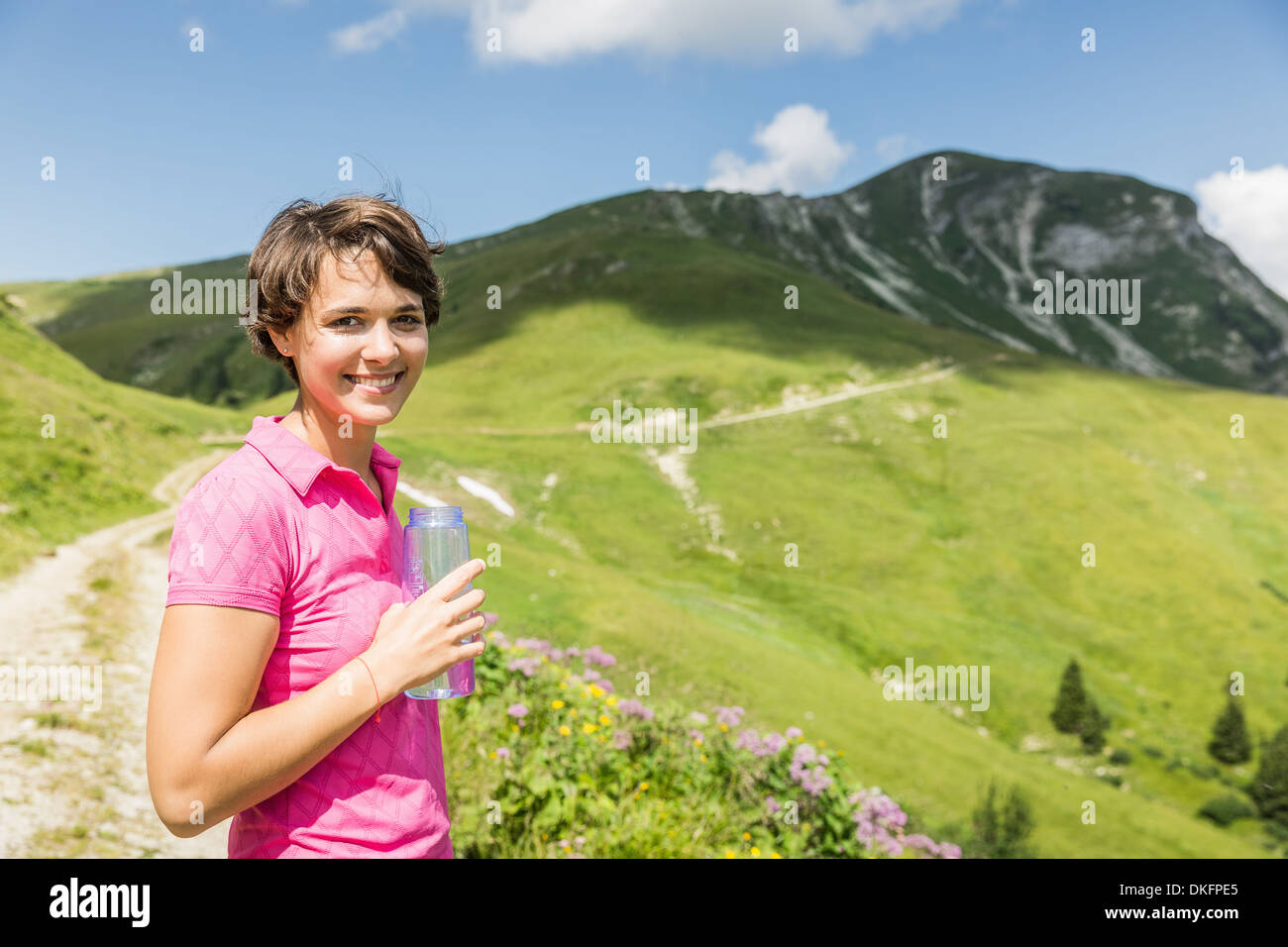 Young female hiker with bottled water, Tyrol, Austria - Stock Image