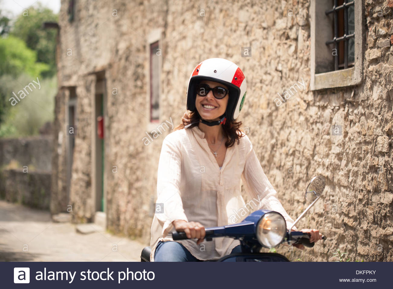 Woman exploring Florence on moped, Italy - Stock Image