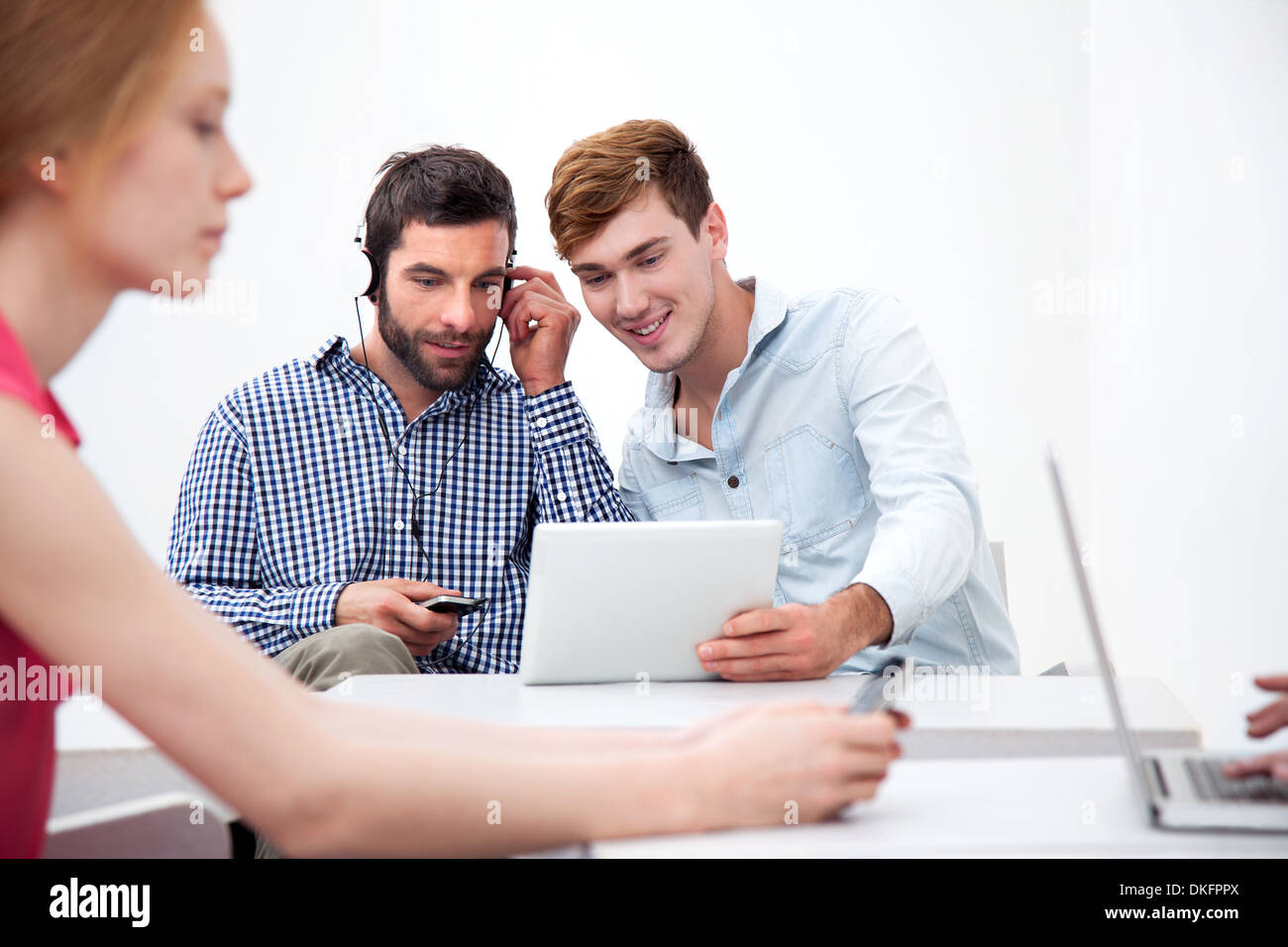 Two male colleagues using digital tablet - Stock Image