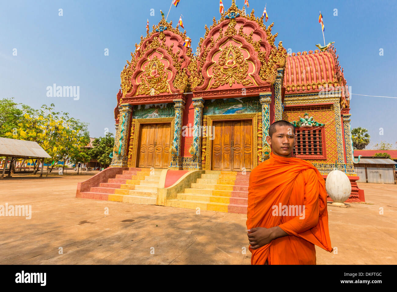 A young Buddhist monk at Wat (Phnom) Hanchey, on the Mekong River, Kampong Cham Province, Cambodia, Southeast Asia Stock Photo