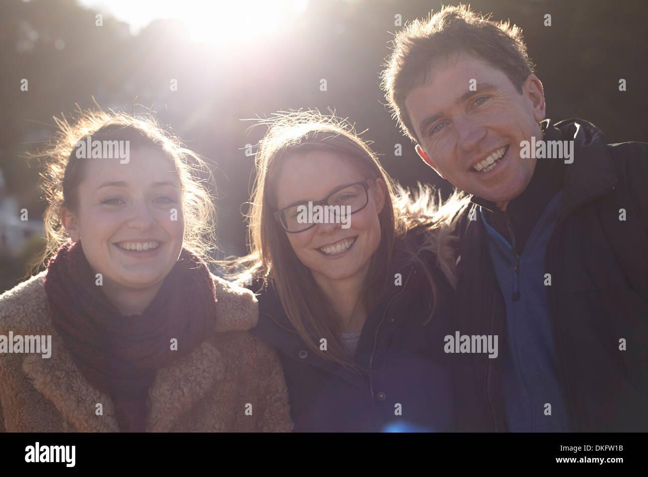 Friends on day trip in Devon, UK wearing winter clothing - Stock Image