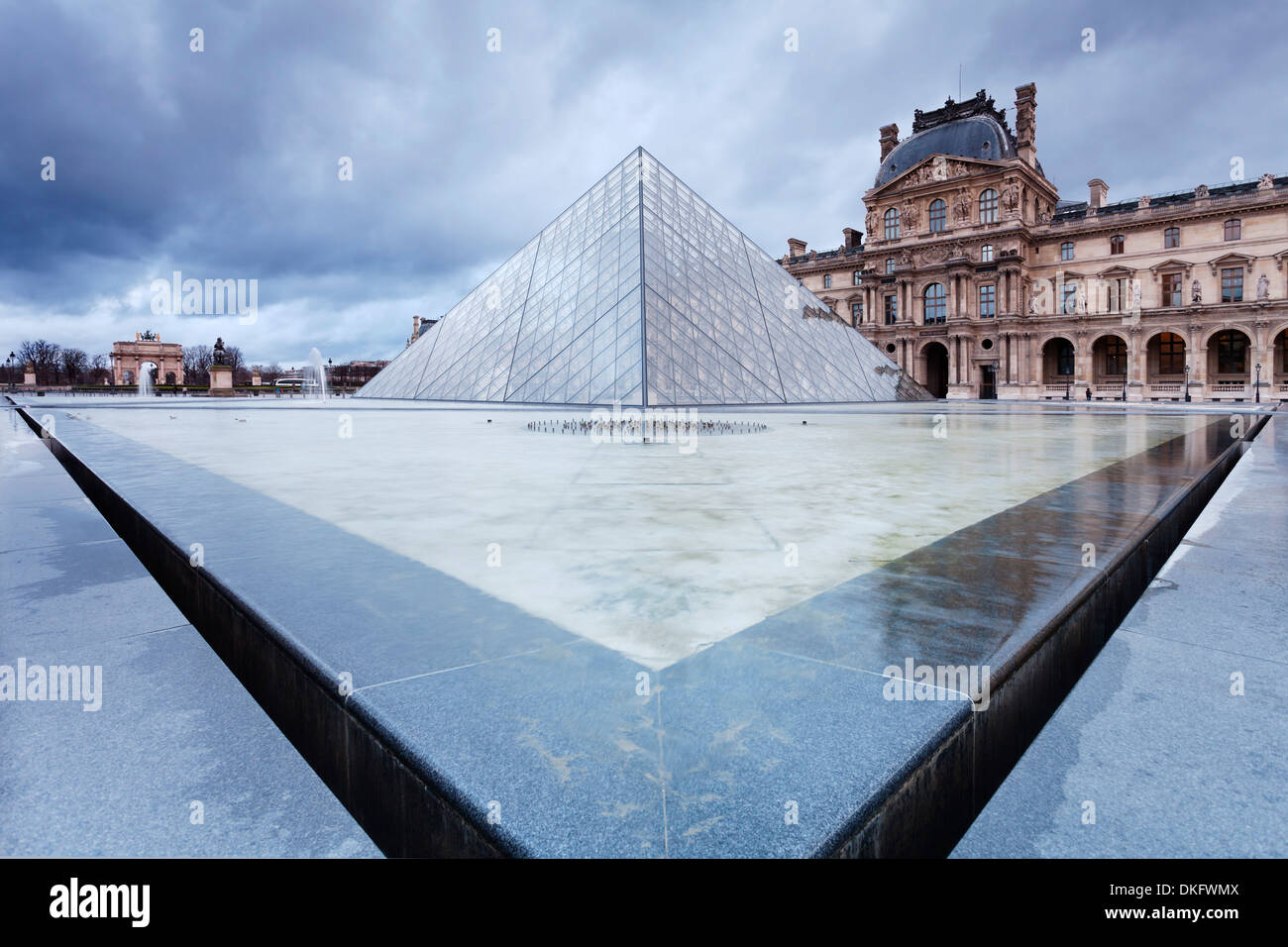 Louvre Museum and pyramid, Paris, Ile de France, France, Europe - Stock Image