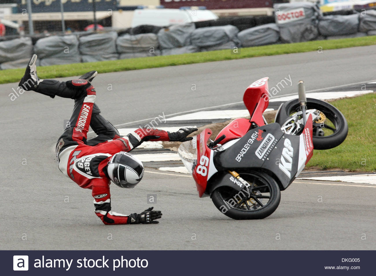 Wild Card entry, james Lodge crashes out in spectacular style on his KRP/Bradley Smith 125cc Honda causing the race Stock Photo
