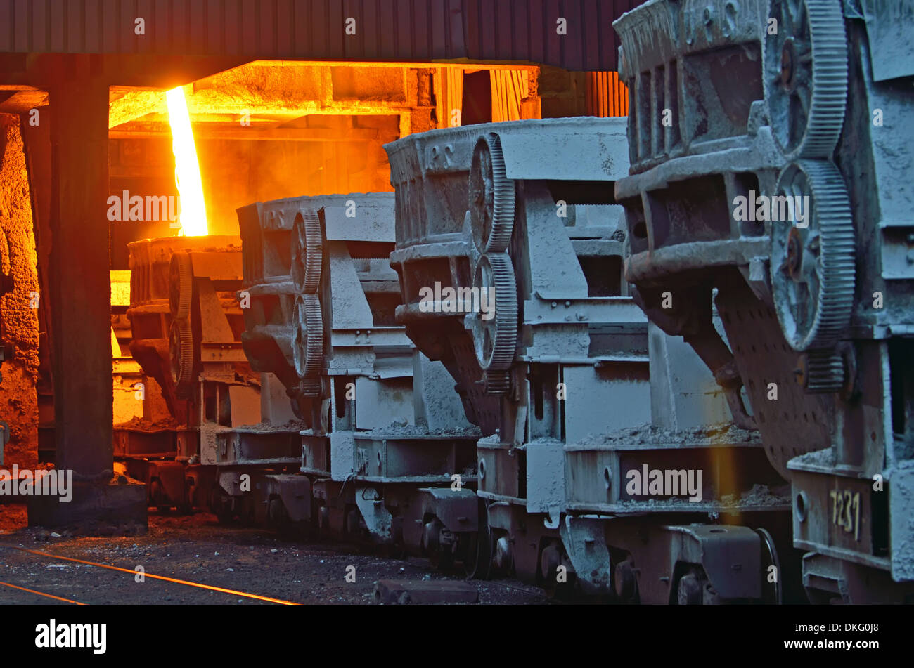 steel buckets to transport the molten metal inside of plant - Stock Image