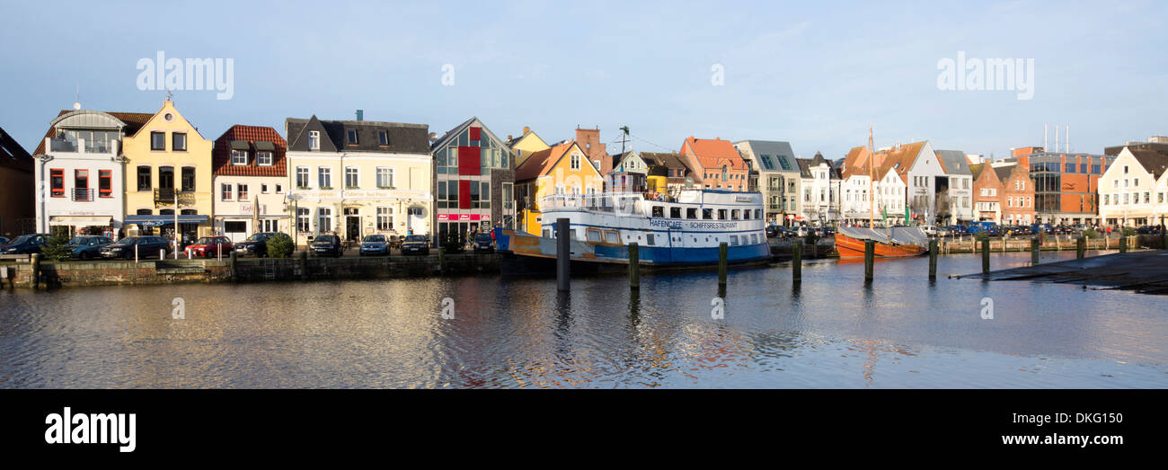 inland harbour with harbour road, husum city, schleswig-holstein, germany, europe - Stock Image