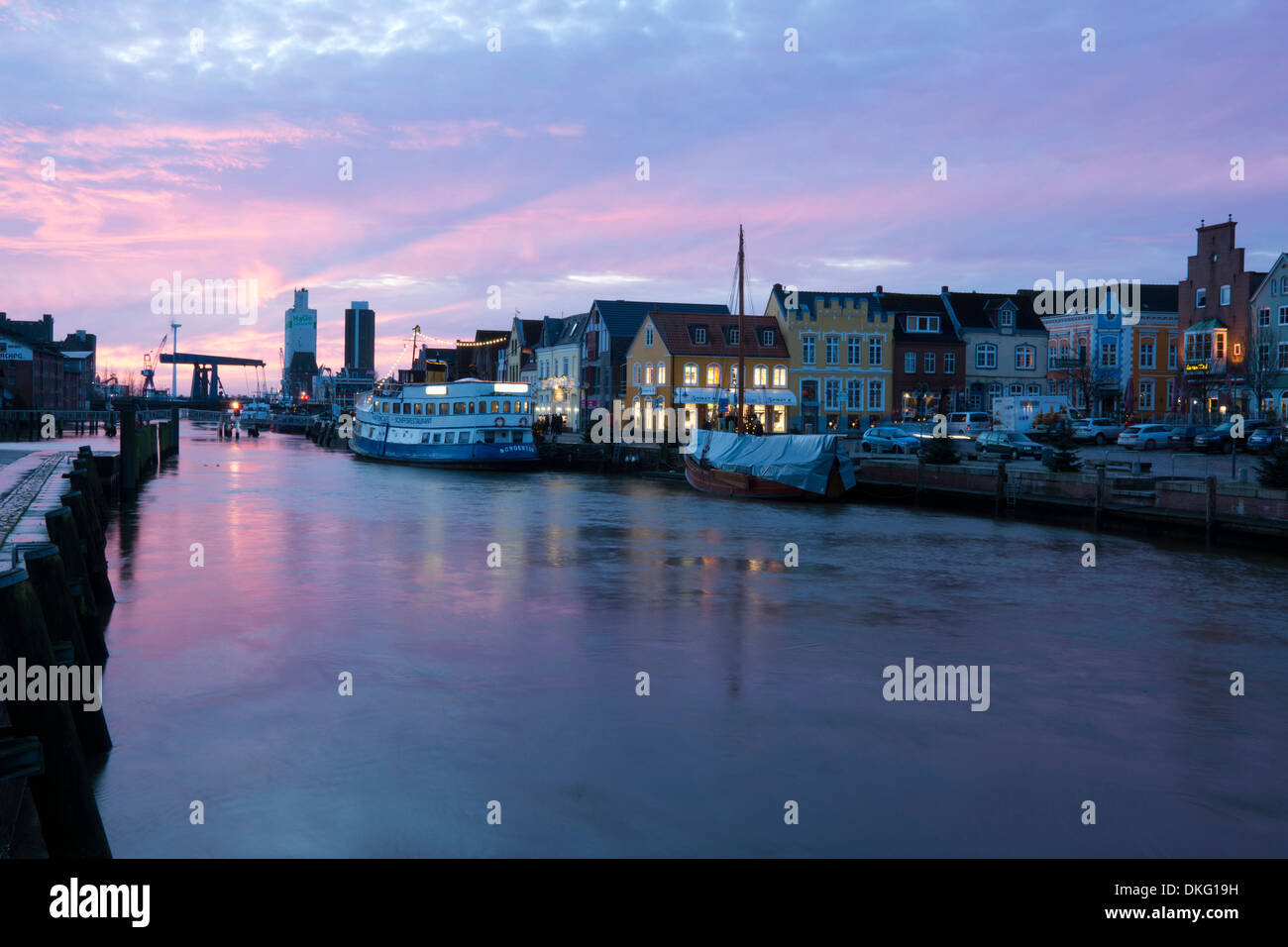 sunset over inland harbour with harbour road, husum city, schleswig-holstein, germany, europe - Stock Image