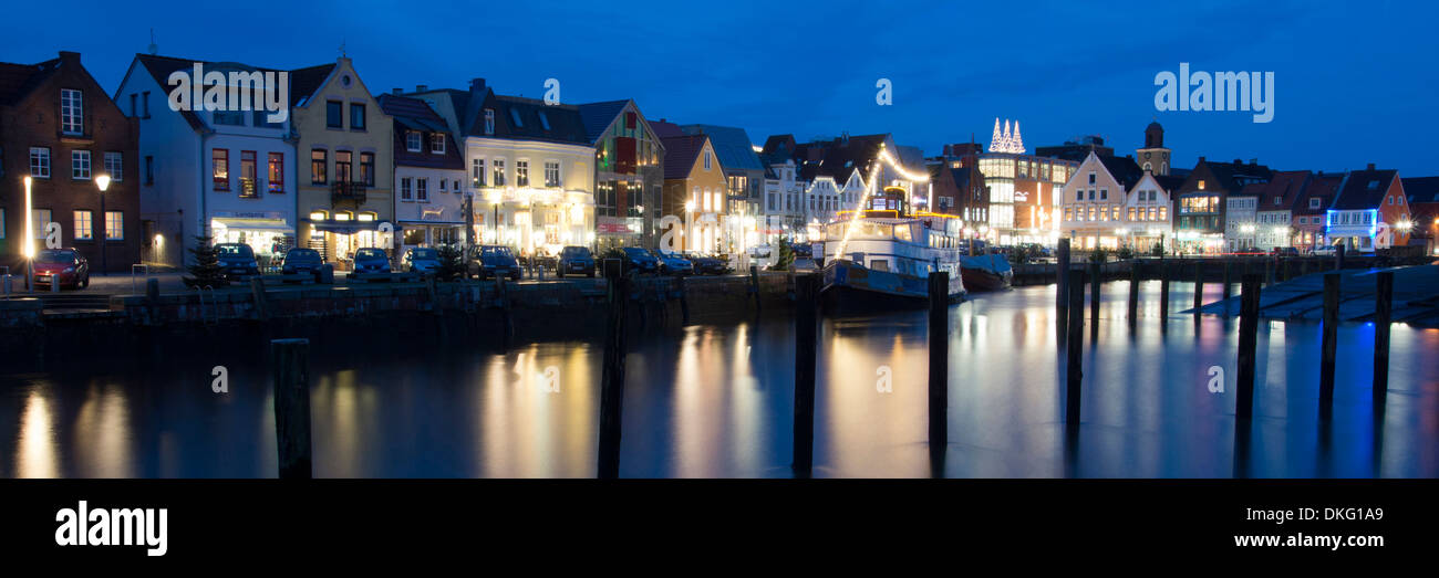 evening light over inland harbour with harbour road, husum city, schleswig-holstein, germany, europe - Stock Image