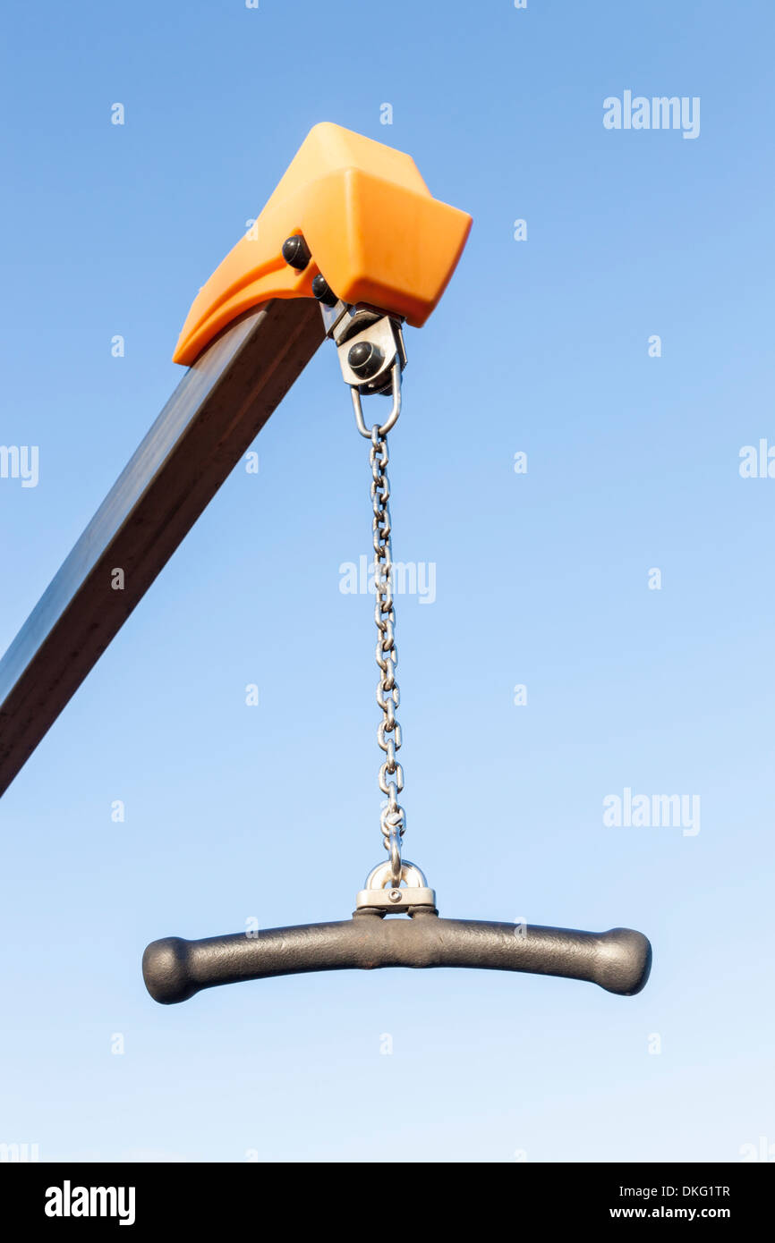 Child's cantilever swing in a playground for children to hang from - Stock Image