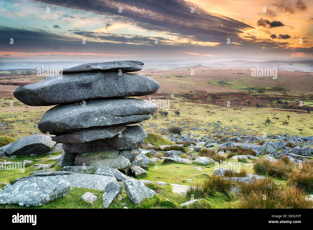 Sunset at the Cheesewring on Bodmin Moor in Cornwall, a weathered natural rock formation made up of precariously balanced granit - Stock Image