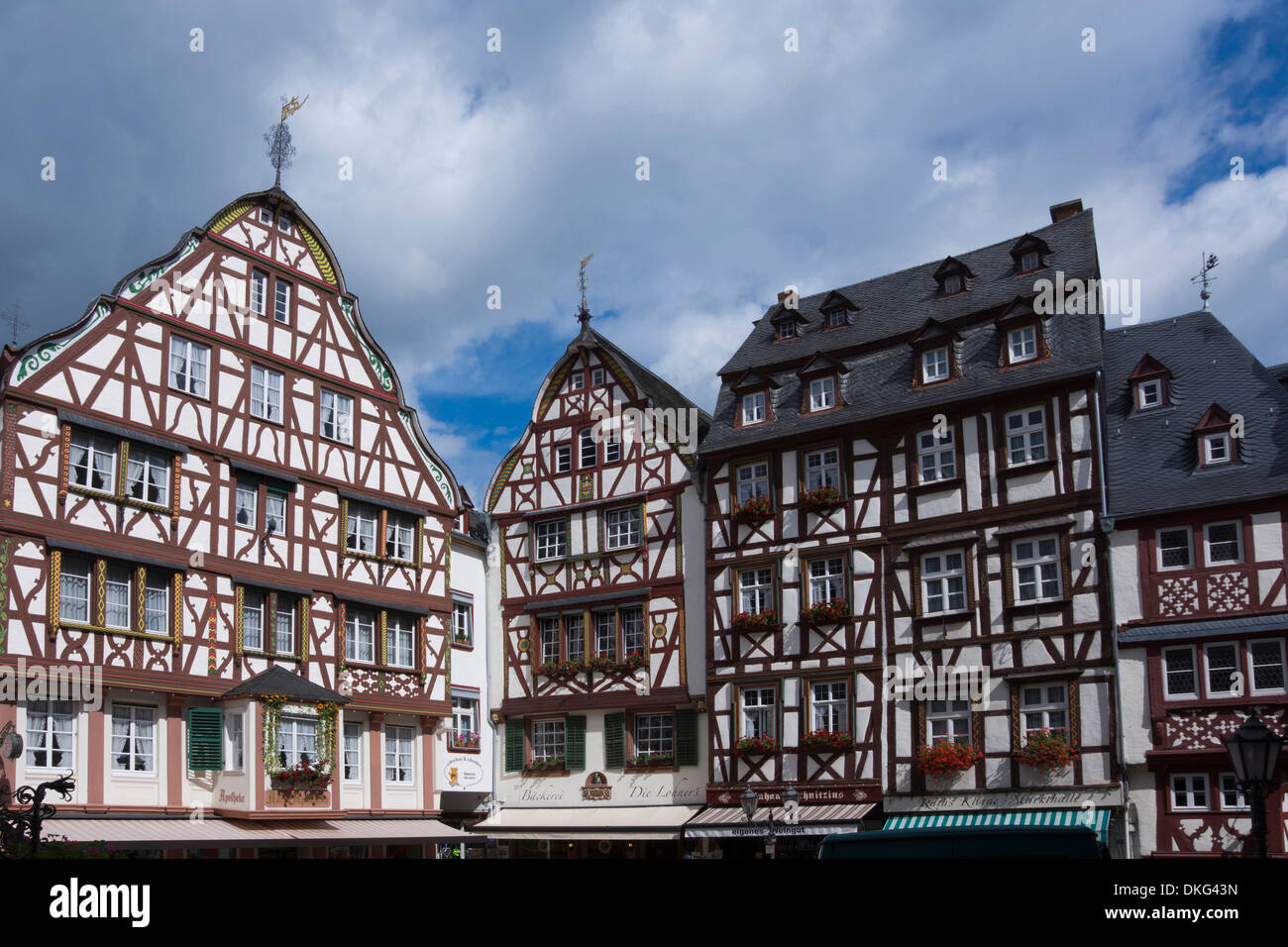 Half timbered houses at the market square in Bernkastel village, Bernkastel-Kues village, Moselle, Rhineland-Palatinate, Germany - Stock Image