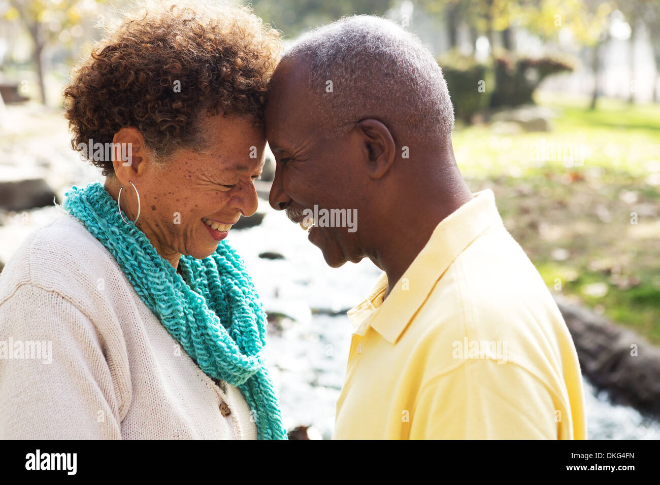 Senior couple face to face, smiling - Stock Image