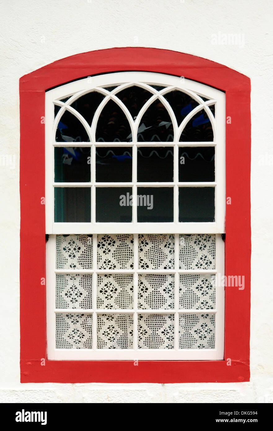 Lovingly decorated house window in Paraty's historic center; Paraty, Espirito Santo, Brazil. - Stock Image