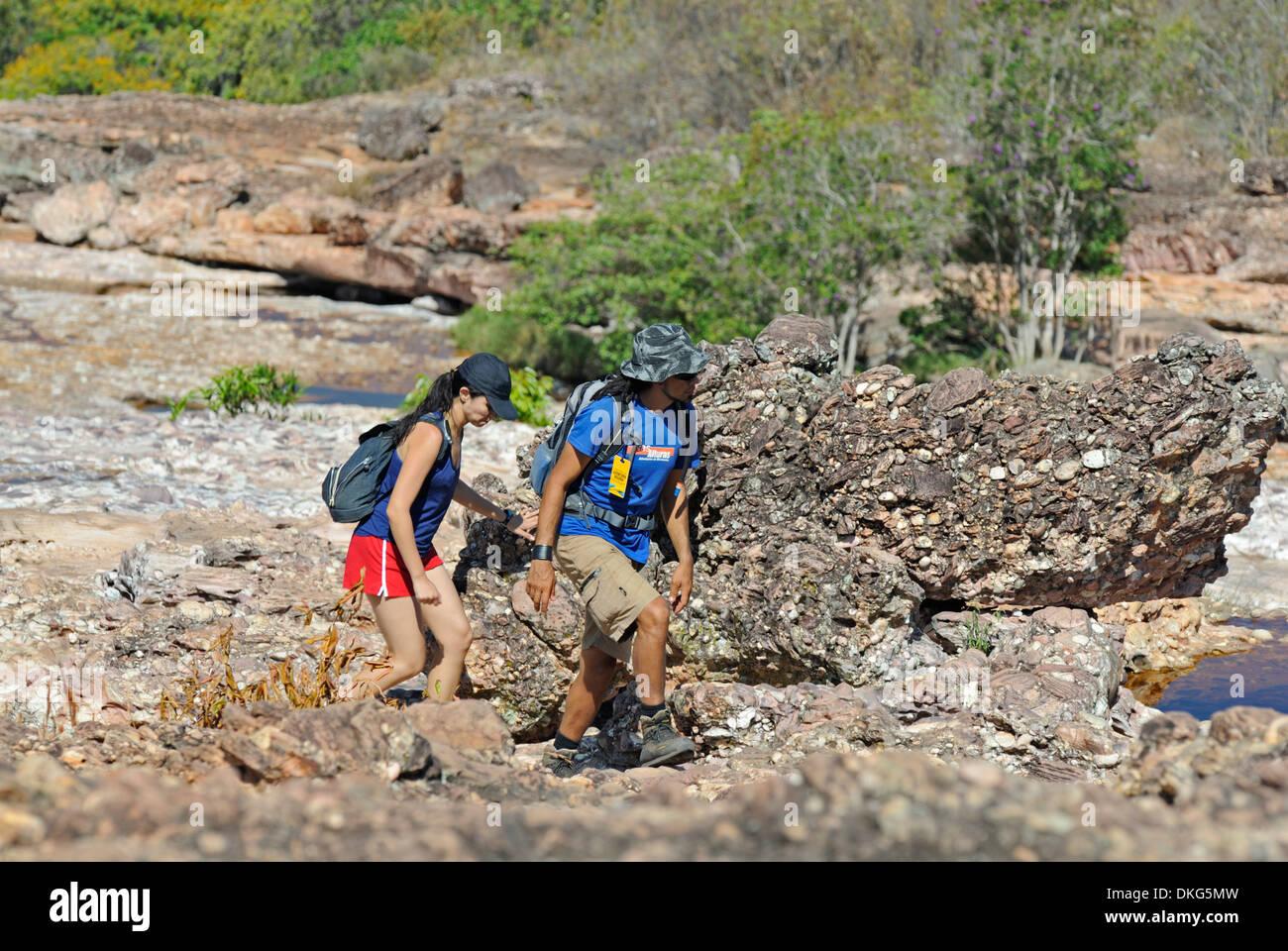 Chapada Diamantina, Lencois, Bahia, Brazil: Female tourist with her tour guide returning from a nature hike ... - Stock Image