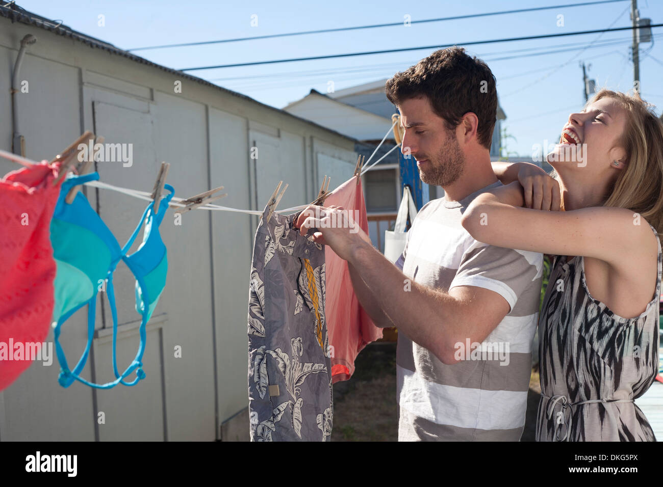 Couple hanging out swimwear, Breezy Point, Queens, New York, USA - Stock Image