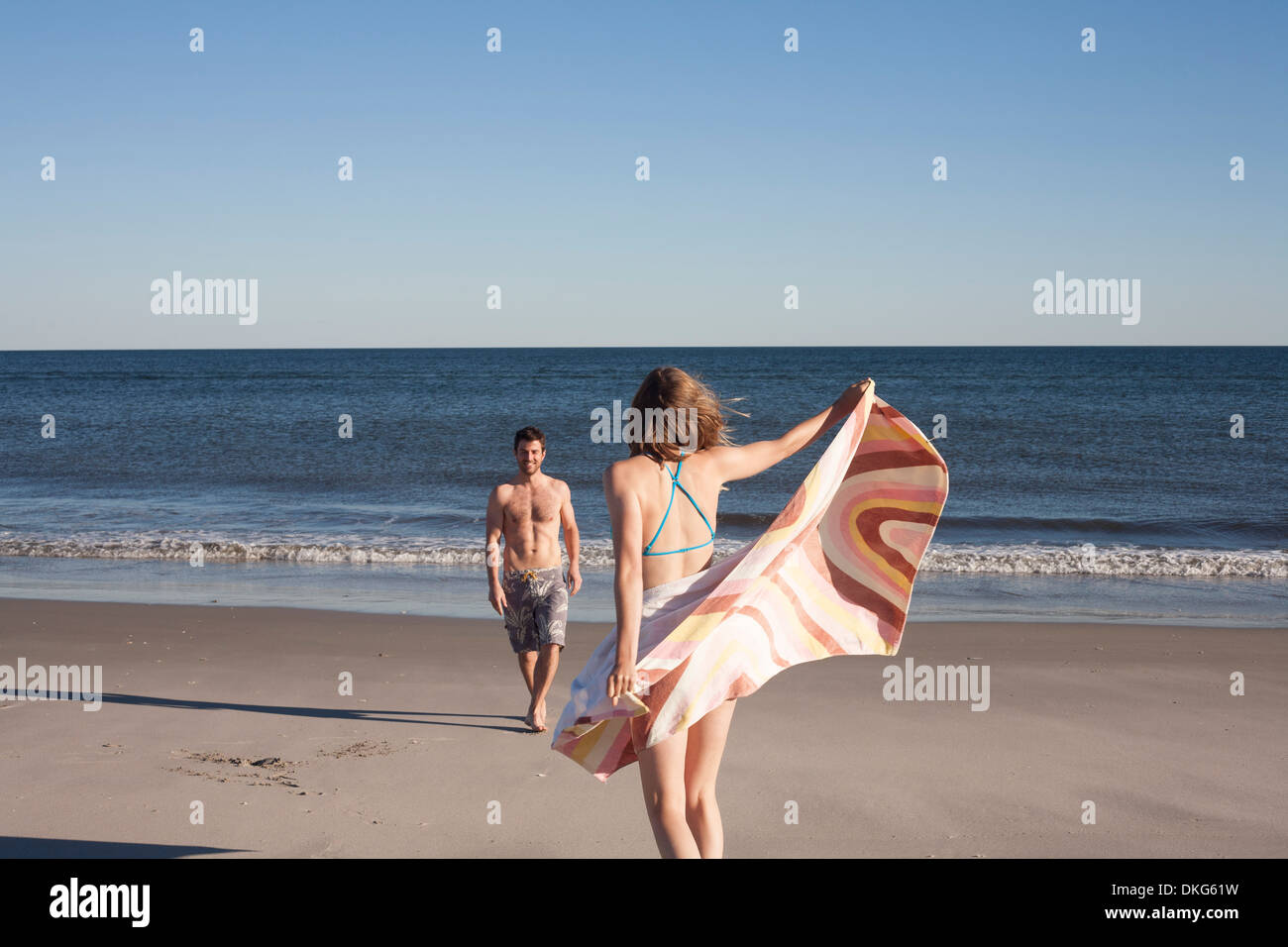 Couple on beach, Breezy Point, Queens, New York, USA - Stock Image