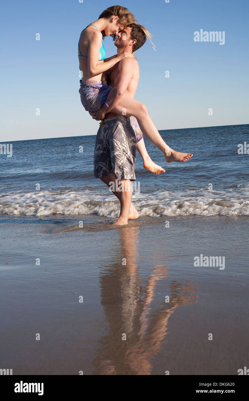 Couple having fun on beach, Breezy Point, Queens, New York, USA - Stock Image
