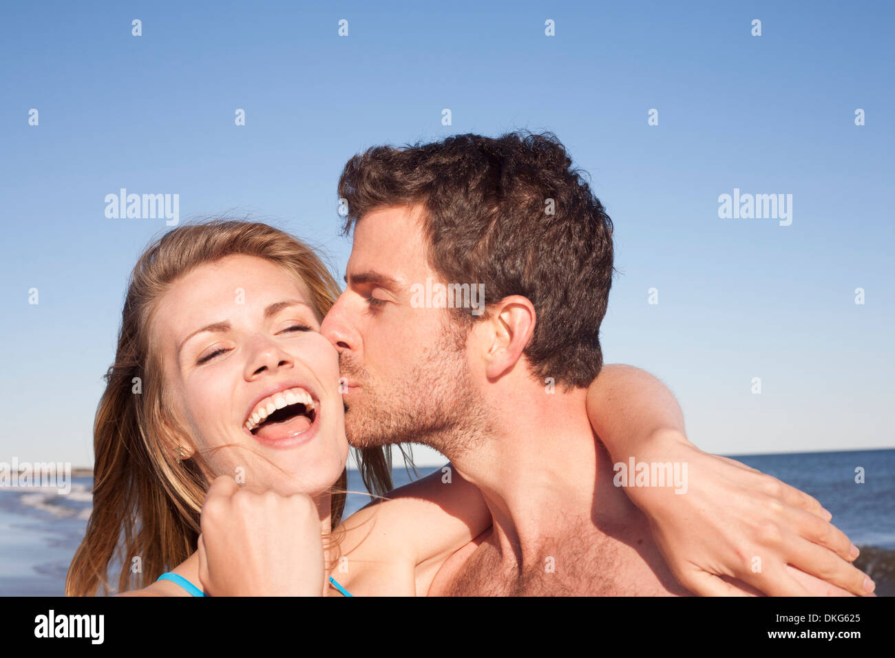 Close up portrait of couple on beach, Breezy Point, Queens, New York, USA Stock Photo