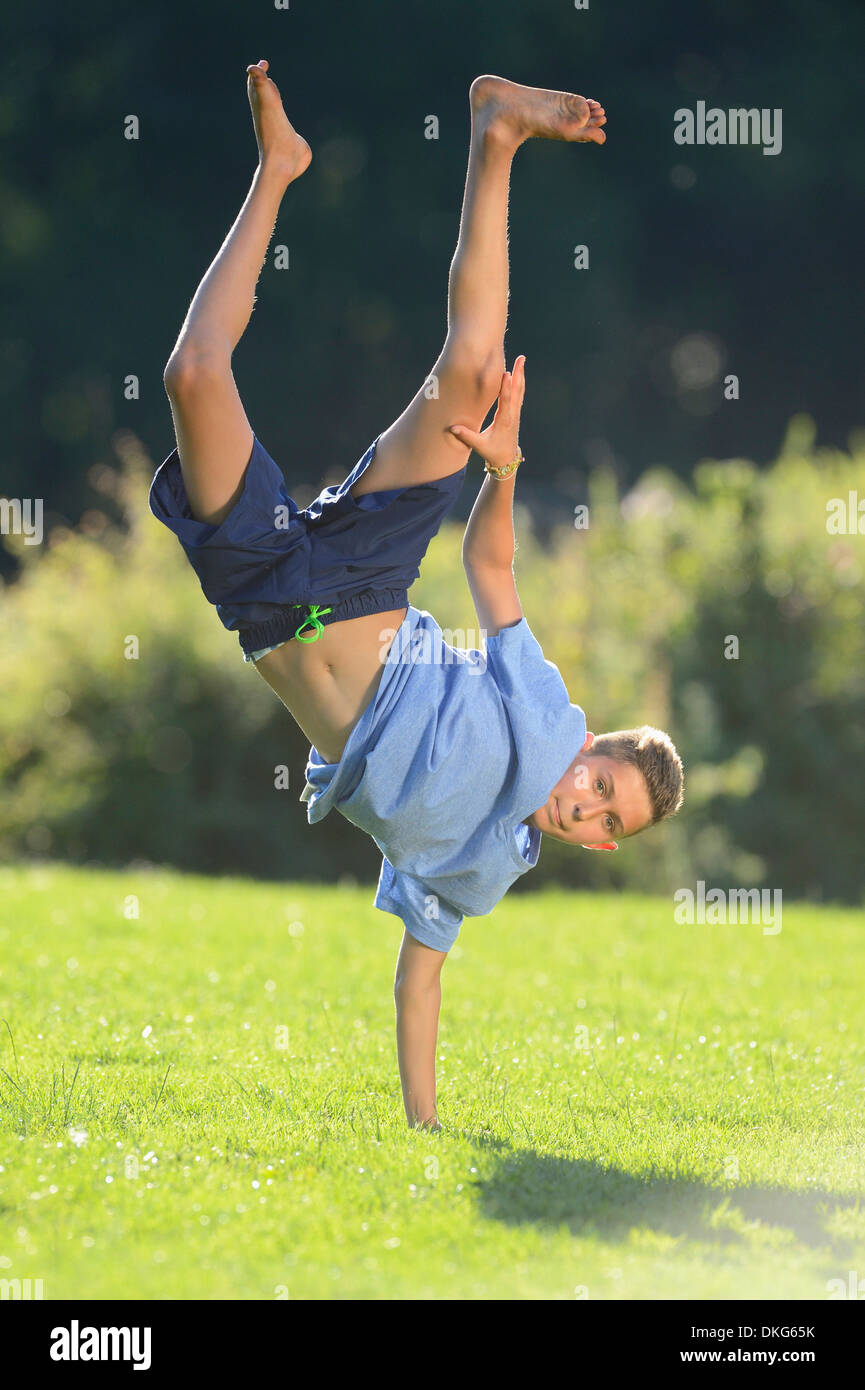 Teenager doing a handstand, Upper Palatinate, Bavaria, Germany, Europe - Stock Image