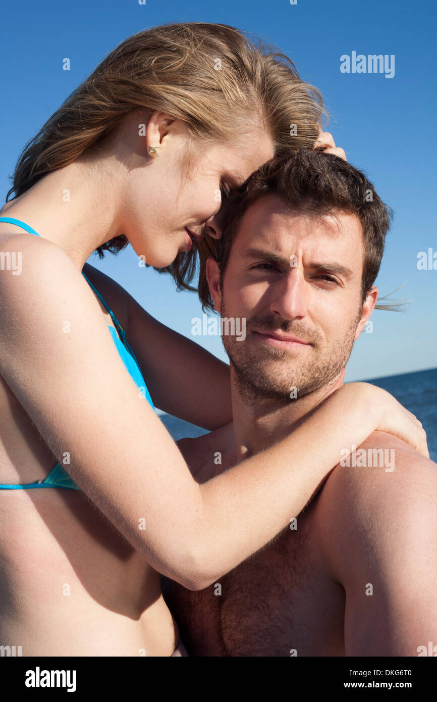 Close of couple on beach, Breezy Point, Queens, New York, USA - Stock Image