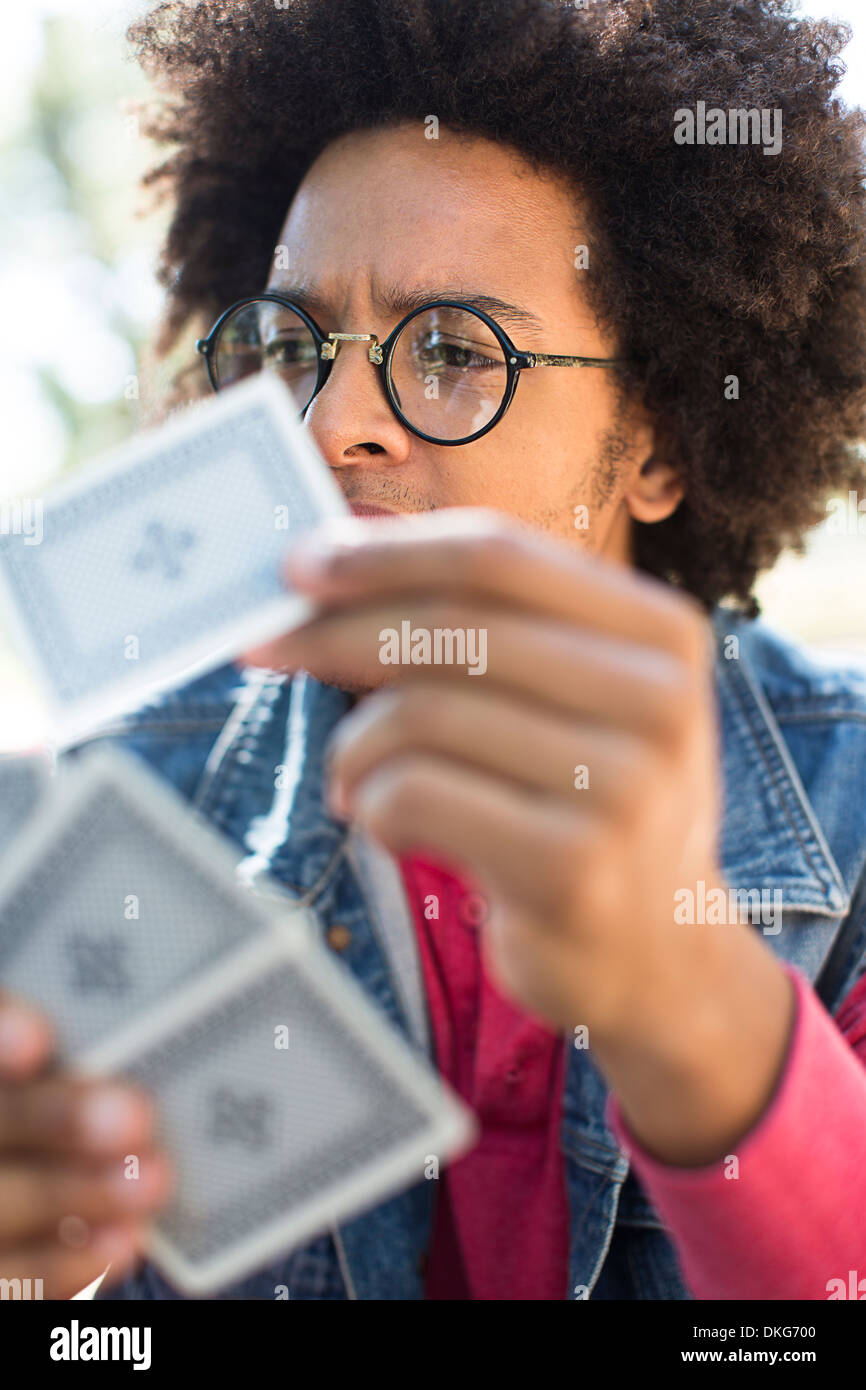 Young man playing cards - Stock Image