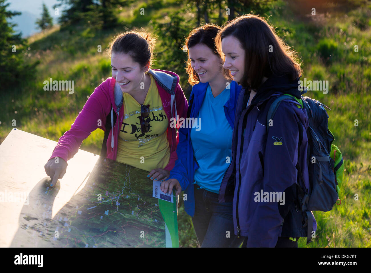 Three young women hiking, Hochkoenig, Berchtesgaden Alps, Salzburger Land, Austria, Europe - Stock Image